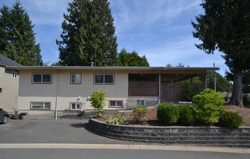 HERE IS YOUR CHANCE TO BUILD YOUR DREAM HOME! Surrounded by new upscale homes, this huge 9690 SQFT lot is situated close to UFV with two road frontages, Currently has a clean solid-two storey home (2460 SQFT) with awesome rental income ($2200/month) with great tenants. Newer torch on roof, basement if roughed in kitchen for future suite. Centrally located & family oriented neighbourhood! Close to all amenities. Shopping, Park, Schools, and Quick freeway access. Great investment opportunity with tons of potential! PUT THIS ON YOUR MUST VIEW LIST!!