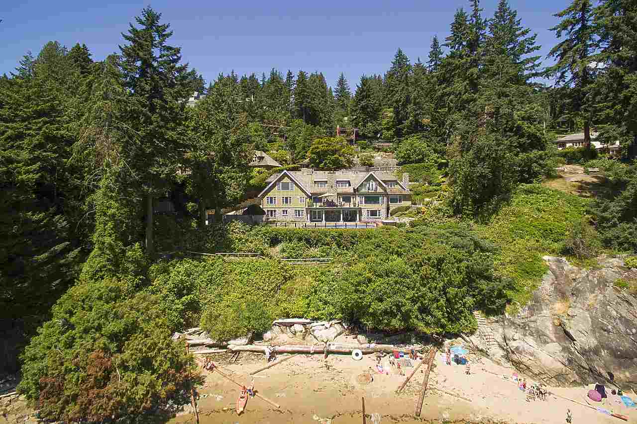 Situated on .56 acre above gorgeous sand beach, about 80 feet access on front, offering natural privacy, gated entry with CCTV, over 198 ft of waterfront, surrounded by park, full city view, quiet, no wind & all day sunny south setting. Offering more than 7,800 SF of living space on 3 levels, 5 bedrooms, 6 baths, sauna, guest accommodation, 4 car garage, 10 car open parking open, outdoor swimming pool, hot tub, private workshop, geo-thermal & gas dual heating, heated concrete flooring, German cherry flooring, sold cherry doors, cherry walls, maple cabinets, gold plated 1970?s Swarovski crystal chandeliers, gold plated ceiling light casings, hand crafted copper gutting system, etc. Enjoys the privilege of the the southern waterfront view without any obstruction based on the License.