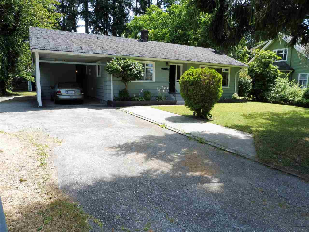 NICE BIG FLAT LOT, 10,400 SQ FT in the heart of Maple Ridge. This rancher is a great rental property or great opportunity to build your dream home. Furnace is 3 yrs old. Laminate flooring & carpeting in the bedrooms. Wood fireplace. Close to Glenwood Elementary, Shopping, Transit, Parks and much more. Single carport. Old style detached garage and shop behind the house with 220 wiring. Very clean!