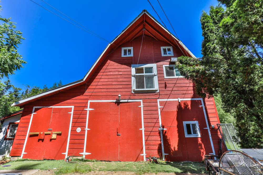 Huge country 5 bedroom farmhouse on 2.2 mostly flat, quiet acres with 2 huge red barns - One 40x40 and 40x20 apartment/suite above. 2nd barn is 60x40. Year-round creek on corner of property. 10 minutes to downtown. Bring your ideas. Perfect for farm, horses, shop.