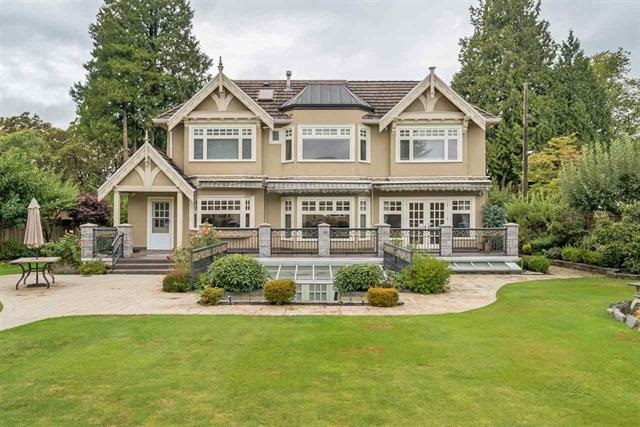 Locates in the heart of prestigious South Granville in Vancouver West side, a large 16,460 sqft (90'x182.89') lot with a gorgeous custom built home. With near 8000 sqft of spacious living space, it features extra high ceiling, grand foyer, top of line appliances, granite countertops, radiant heat, central A/C, top maple hardwood floor. Four good size bedroom all ensuite, huge master bedroom with a sophisticated walk-in closet, and spa like bathroom. Basement with huge entertainment area, Sauna and 2 bedrooms. Beautiful landscape in back yard garden. This house sits on a quiet and treed area on famous Adera st, close to famous St. George, Crofton House, Little flower academy and easy transit to UBC. Very close to Magee Secondary.