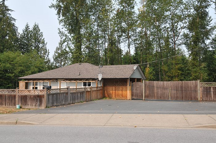 Opportunity's Knocking! Close to town acreage, 1.29 acres on city water and sewer! Totally private Backing Green space! The land has endless potential to create your dream yard. This Rancher with walkout basement has had many updates over the years. Loads of parking for your toy's and future yard development. Full basement awaiting your ideas. Walk to Schools and Town!