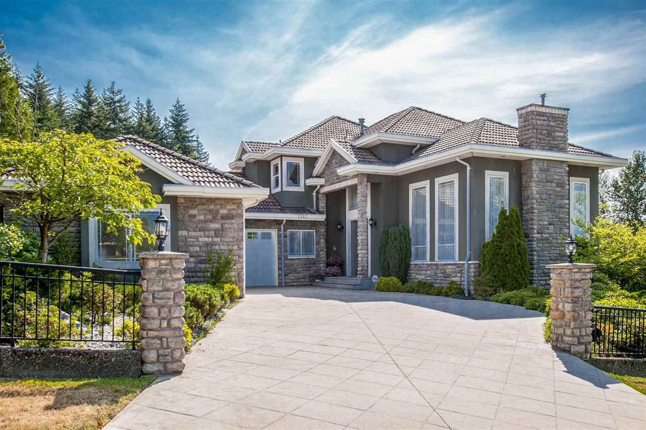 LUXURIOUS Move-in ready CUSTOM built 6 bdrm & 5.5 bath home w/VIEWS steps from Westwood Plateau Golf Course. 10,900 sq ft CORNER lot, w/over 5400 sq ft of high end, show home quality renos. Double high ceiling foyer, w/stunning floor to ceiling custom stone F/P in big living rm. Natural light shines from extra large windows all thru-out. Architectural design & pillars incl: double wide crown moldings & coffered ceilings. Enjoy solid oak wood floors on main & upstairs. Entertainer's kitchen incl: SS high end appls, 6 burner gas range, double ovens & dishwashers & sub-zero fridge. 4 spacious bdrms up. HUGE master w/SOUTH VIEWS & BATH W/2 rain showers. Above ground bsmt w/rec rm & wet bar. Separate 2 bdrm inlaw suite.
