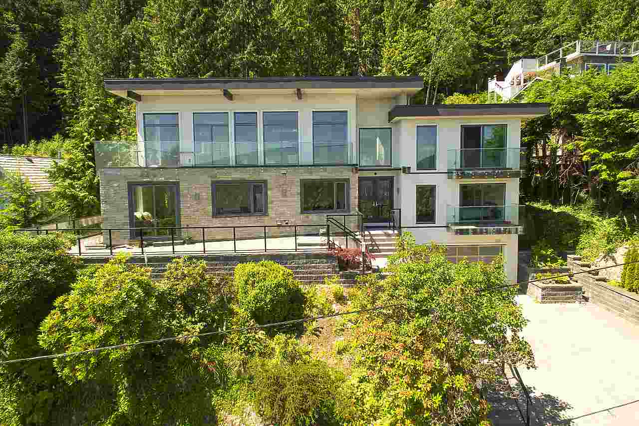 """SENSATIONAL FAMILY HOME W/2-BDRM IN-LAW SUITE & PANORAMIC VIEW OF DWNTN, LIONS GATE BRIDGE & STANLEY PARK! This amazing home has it all! Take the elevator to upper flr and you will have full & complete living ALL on ONE LEVEL w/ALL principal rms over-looking the view. Upper Flr features high ceiling, large private living rm & dining rm, oversized family room, stunning gourmet kitchen w/Miele appl, WOK kitchen, eating nook, huge en-suited master bdrm, plus 3 en-suited bdrms. Lower flr: huge media rm w/blue-tooth surround sound, 3D proj & 300"""" screen, rec-room, spacious guest bdrm, office, plus stunning 2-bdrm/2-level in-law suite w/amazing great room, kitchen & view. Also: FLAT DRIVEWAY, all walls & floors sound insulated."""