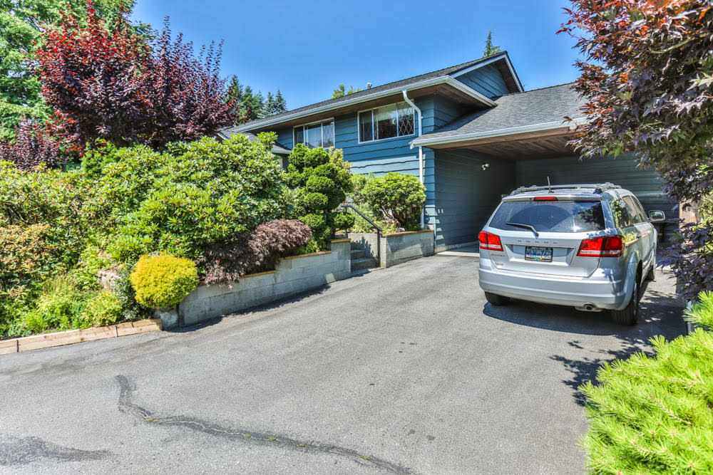 GARDENERS DREAM!  Over 8000 sq. ft. lot with 2800 sq. ft. Brauer Built, Family home (easily suitable) in sought after West Central Maple Ridge location.  Oversized Double carport with Storage and Wine Cellar. Inside are 4 bedrooms, and 3 bathrooms, 2 Cozy Wood-Burning fireplaces, Large Recreation room down (Seller would like to leave Billiard table, but will have it removed at Buyers choosing).  Very well maintained home, priced for quick sale! Open House Sat/Sun August 12th and 13th 2:00-4:00.