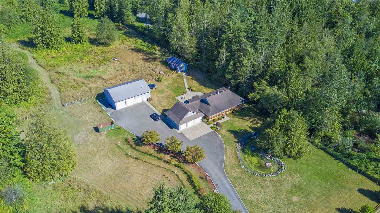 This is a beautiful, quiet, and well maintained 4.12 acre property, boasting a rural setting yet only minutes to town. Featuring over 1700 square feet, this 3 bedroom rancher with an open concept floor plan is sure to meet all of your needs. Enjoy an oversized triple car garage, fresh paint, an updated kitchen, updated flooring, and a large private patio for BBQ's with the whole family. This property also features a full asphalt driveway, leading to a 40 'x 60' shop, with 3 overhead doors, 2 are 12' high. This acreage is fenced, cross fenced, and even has a small barn and chicken coop. There is also a secondary residence on this property, which is currently rented for $800.00 a month. Call today!