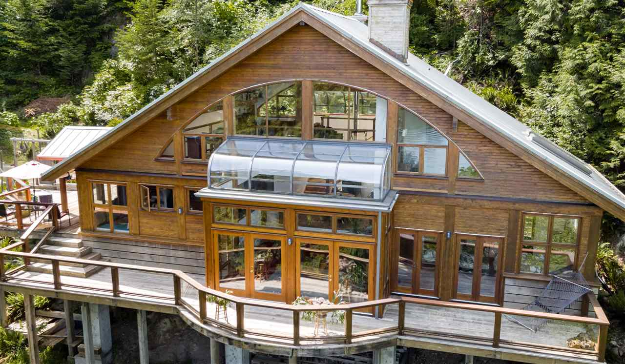 Otter Point is an architect - designed waterfront home on the north shore of Bowen Island. Enjoy the beautiful views of the Howe Sound Fjord to the Tantalus range, the Black Tusk and Garibaldi Glacier. If you want to live at one with Nature, this is your House! Two atriums set off an open plan design with soaring ceilings, pine and terra cotta floors and a large deck accessed by French doors from both the living room and the master bedroom. Fall asleep to the gentle sound of the waves lapping the pebbly beach outside - beautifully acoustic and accessible. A Finnish Tulikivi soapstone thermal mass fireplace keeps things cozy in winter. Matching soapstone counters and the open kitchen design make Otter Point perfect for entertaining.