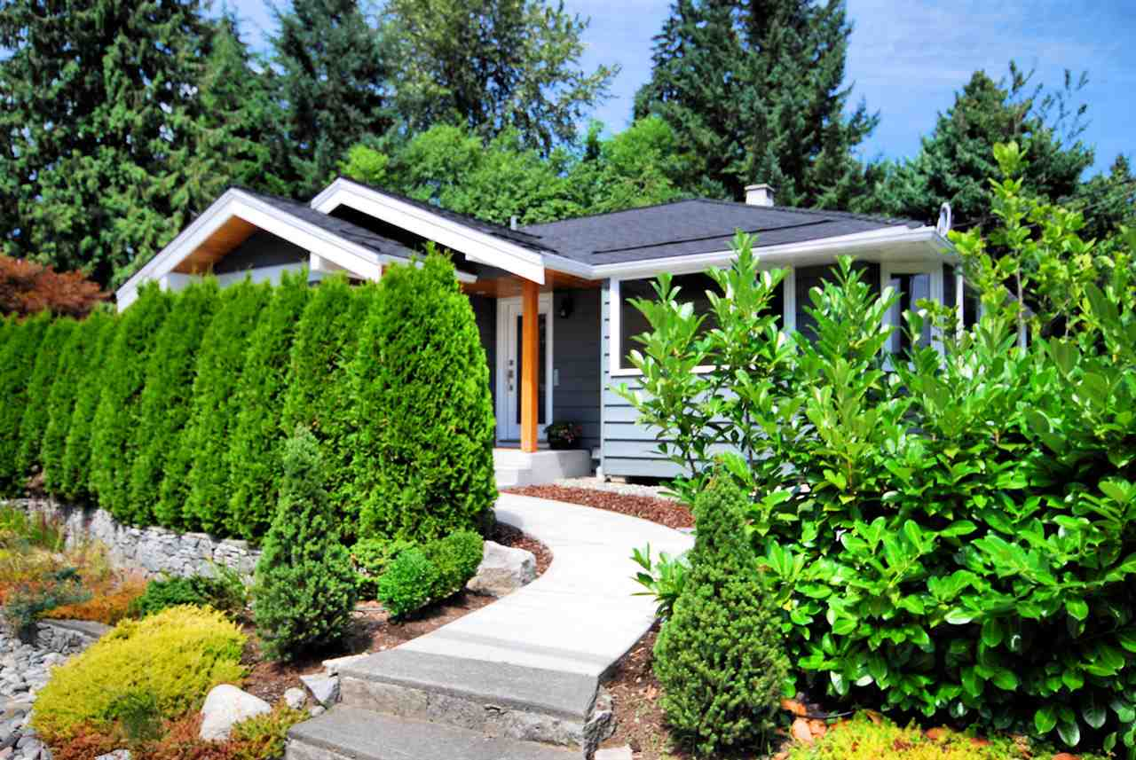 Cozy 2 level home just literal steps from the shopping amenities of Edgemont Village and an extremely short drive to the new Delbrook Rec Centre.  This is one floor living with the kitchen, living room and dining room on the same main level as the master bedroom and a second bedroom.  A renovation added a new office and a new bathroom to the main floor 3 years ago.  Below the main is a rec room, bedroom, kitchen and laundry room along with a gym that was added in the same renovation.  The home is in move in condition with a newer roof and furnace and sits on a level 8400 sq ft lot.  A mature hedge separates the home from Edgemont Blvd to give it a little extra privacy.