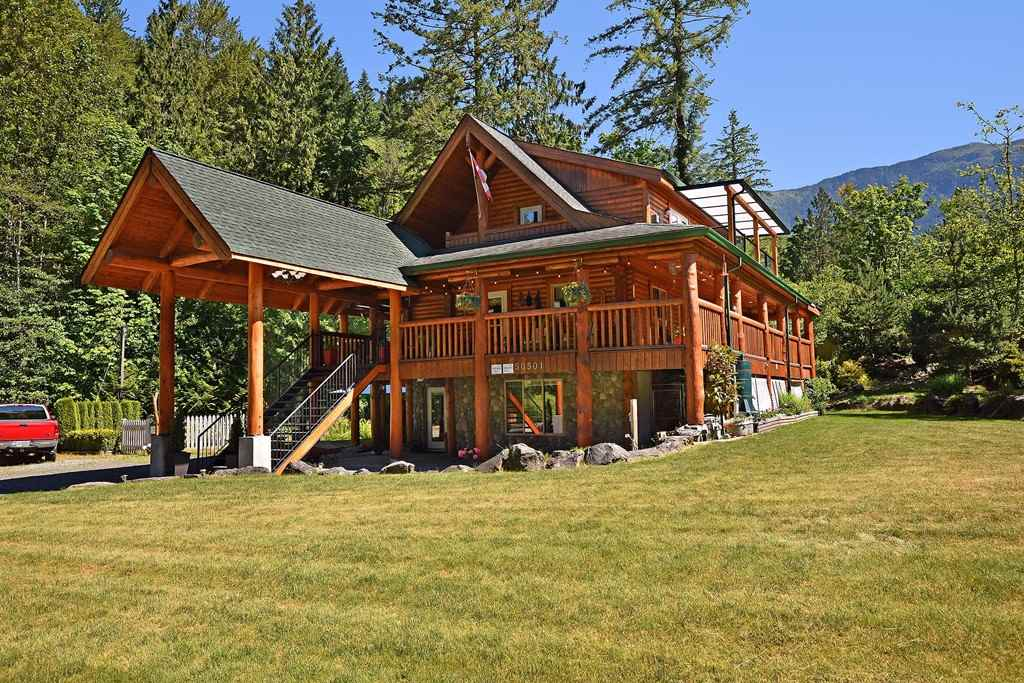 Pristine Private River-Front 2700+ SQFT 2-Story With BSMT Log home on over 3 acres of forest that extends to Chilliwack River. 4 Bedrooms and Den, 3 Full Bathrooms with Heated Tile floors. 4 F/P (3 Gas and 1 Electric). Open Concept Kitchen has Tons of Cupboard space and large Island for entertaining as well as pantry. Gas range, 2 y/o Wall Oven. 1 Bed and Den on Main Floor as well as cozy living room. Full wrap around deck. Upstairs has large Master Bedroom with high ceilings, walk out to Balcony and ensuite as well as WIC and 2nd bed. Downstairs has separate entrance with suite potential. Approx 3/4 acre of landscaped space with Waterfall features. This could be a great Bed and Breakfast, weekend get-away or year-round home.