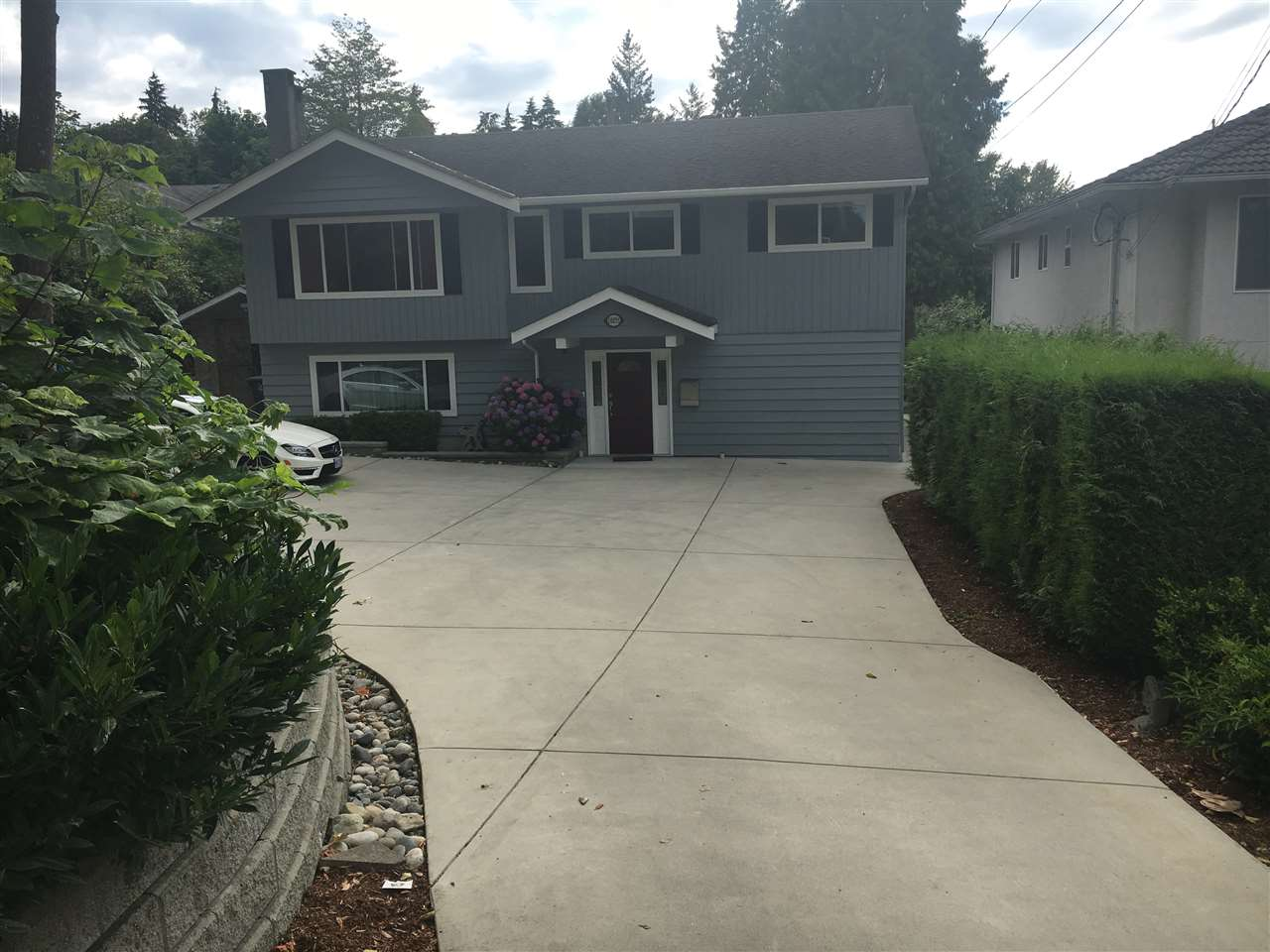 A well-kept 4BR, 2 full bath, 2-level home located NOT along busy Scott Rd but on a quiet setting away from traffic. Renovated new Kitchen with S/S appliances, built-in wall oven w/microwave, induction cooktop w/chimney hood, quartz countertop, ample cupboard space & tiled flooring. Relax on the covered 18'x10' deck off the dining rm. Front & back yards are fully landscaped with retaining walls & lighting. Huge concrete parking for 6 or RV. Adequate space for kids or pets to play around. A short walk to transit & close to schools, Skytrain & Pattullo Bridge. OPEN HOUSE SAT JULY 29TH 1:30-3:30PM & SUN JULY 30TH 2-4PM