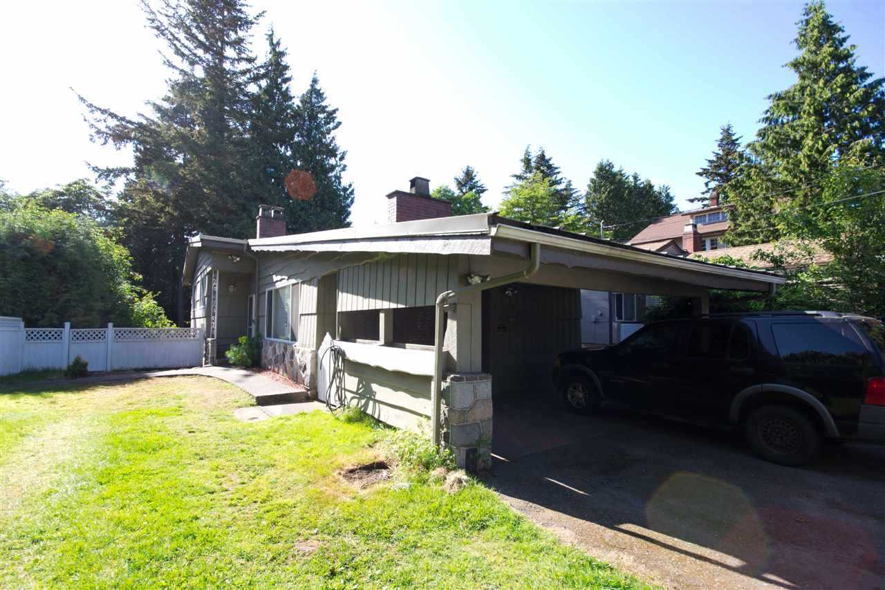SW Marine - Central location, easy access to UBC, airport, shoppings & transportation. This cozy 3 bedrooms up and 1 bedroom suite down, 2 kitchens, newer floors, paintings, separate entry, private yards, 2300 sqft living space setting on 50x120 sqft lot.  Perfect for investment holding property and future dream home. Call today for detail info. A pleasure to show! Don't miss this rare opportunity.