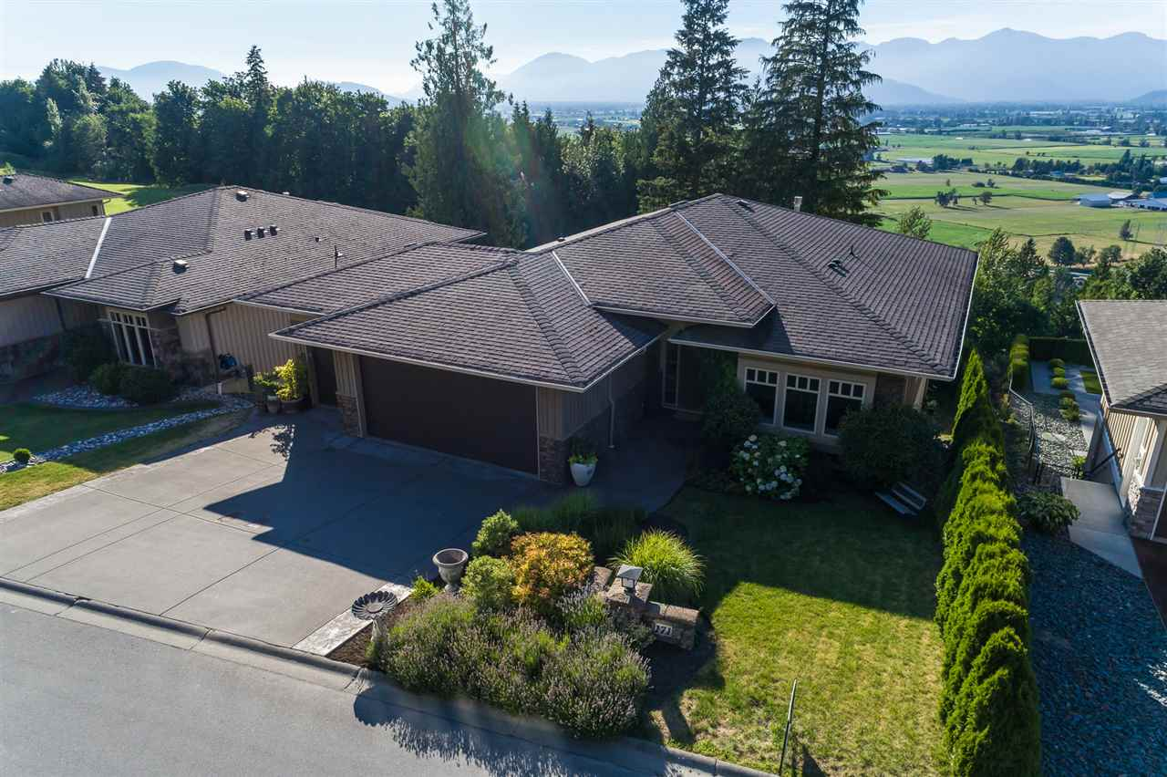 Stunning 4 bdrm/3 bath RANCHER w/ WALKOUT BASEMENT located on a large 9940 sq ft VIEW lot right on the 13th fairway @ The Falls Golf Course! Hardwood, granite, crown mouldings, FRESH PAINT, b.i vac, secuirty, A/C, & TRIPLE GARAGE!! Massive MASTER ON THE MAIN w/ gorgeous 5 piece ensuite w/ oversized soaker tub. Chef's kitchen w/ 2 tiered eating bar, maple cabinets, S/S appliances, & gas range. Finished bsmt w/ 3 bdrms, large rec room w/ gas f/p, & an added unfinished bunker for storage (or media!). Two large entertainers patios (over 650 sq ft!) w/ gas hookups & 180 valley views. Walk right out the basement to your manicured backyard w/ pergola- perfect for the kids and pets! RARE FIND- Bring the whole family- this home has it ALL!