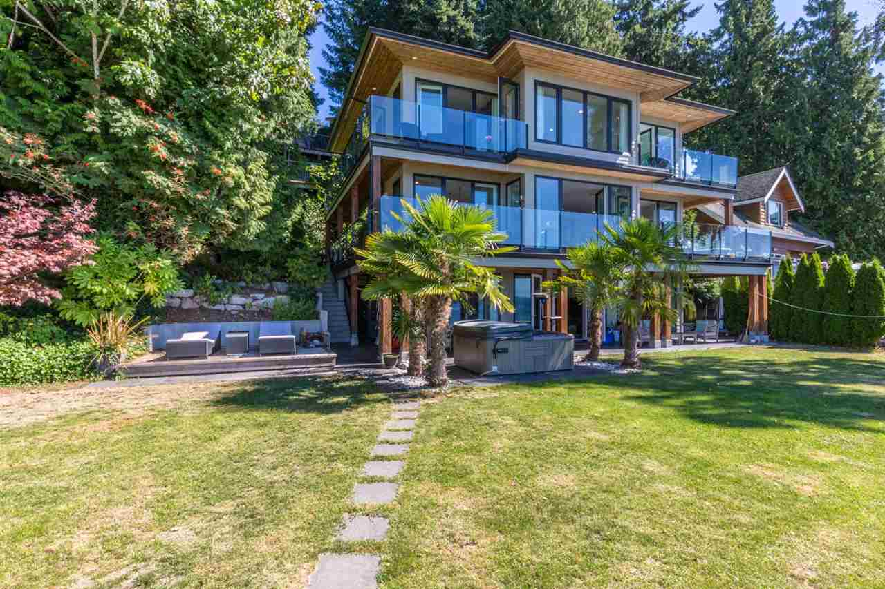 You will be captivated by this custom-built low-bank waterfront home! The perfect recreational getaway located in the heart of Roberts Creek. Exquisitely renovated large family home with guest cottage sits on a private low bank stretch of beach a short walk from the Roberts Creek cafes, restaurants and shops. The main floor features a large open kitchen/dining and living room perfect for entertaining while the numerous bedrooms and bathrooms allow for large family gatherings with a walk out level to the beach and hot tub. Swim out to the float or launch your jet-ski from your own launching pad, canoe, kayak or paddle to your heart's content. Roberts Creek is located just a short 15 minute ride to the ferry terminal at Langdale and a 40 minute sail through the islands from West Vancouver.