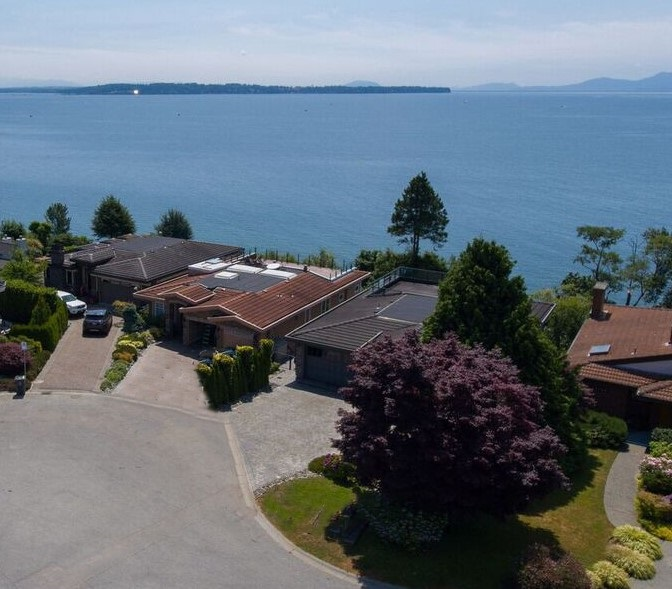 Waterfront Ocean Park  spectacular lifestyle home  with beach access off the property , South of home  sandy shoreline  in tow tide  right  in-front of your home.Wonderful for playing with children or beach dog walks. You can smell the fresh ocean air , see the shore from indoors & hear the waves lapping while  laying in Bed What a fantastic holiday home . Elegant Custom build in 2006 three floors 4816 sq.ft. w/walk out basement, entertainment room full wet bar with seating , leading too full outdoor kitchen built in  and rock faced  with gas fireplace.Entertainers elegant surrounding patio area 837 sq.ft. fully landscaped. Master bdrm suite in on main floor has balcony access all Euroline doors in home . Floors  all enjoy radiant heating & elegant granite surfaces thru-out  home. Built in Dining room buffet bar w/quality  cabinetry  Custom kitchen natural gas stove up w/venting, office on main. Below three bedrooms, media and 2 entertainment rooms. Plenty of storage options. Please preview floor plan & vimeo.
