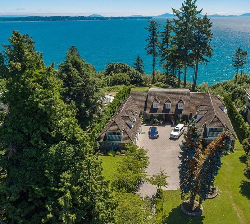 WATERFRONT 1.62 ACRES White Rock/Ocean Park, outstanding gated estate property. Enter through the gates, down the long cherry tree lined driveway & past the 6 bay garages to arrive at the center courtyard. Home is a brick country style sprawling rancher with large loft above. Unauthorized suite above the East garages. A rare private property that is full of Pacific Ocean views and sunsets West. These are the original owners. Custom built home in 1983. Elegant terraced patios South and gracious lawn in front. Zoning RE-1 Estate allows for Max lot coverage 20%, Building Height 25.26ft/Basements/Care Facility/Vacation Rental/B&B - 4 sleeping units - Max 8 Adult Guests. Frontage 109.64'/Depth 648' (as per survey). Rectangular shaped lot, Virtual Tour on Vimeo. Schools: Ray Shepherd and Elgin.