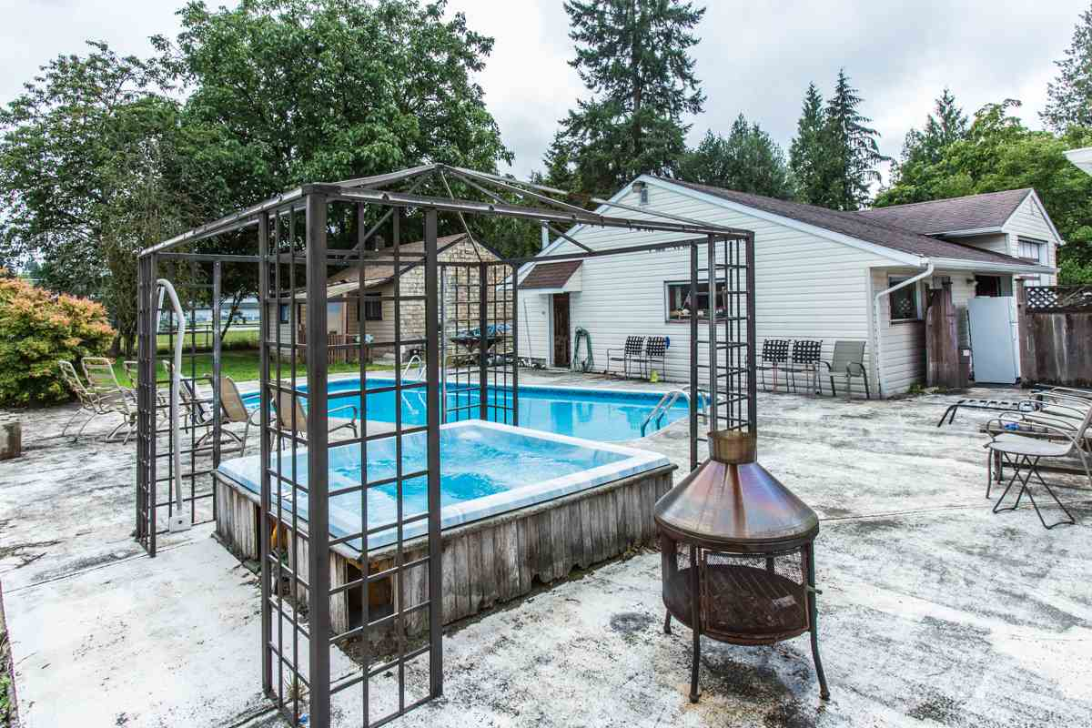JUST UNDER 1/2 ACRE IN WEST MAPLE RIDGE.... with a 2729 s. q. 4 bedroom/3 bath home, one bedroom in-law accommodation, 16'X32' inground swimming pool and hot tub PLUS a detached one bedroom self-contained cabin.  Lot is 90X233 and backs onto Westridge School and is minutes to Parks, shopping, recreation and w C Express station. 30X40  Garage/workshop is wired 220.   A GREAT PACKAGE...