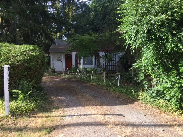 Rarely available: 11,700sf flat lot bordered by mature trees. On quiet street near all shops, amenities in Brookswood neighborhood. This old timer / basic 1500sf rancher with large shed can be rented out until you are ready to build. Value in land & location. Quick completion.