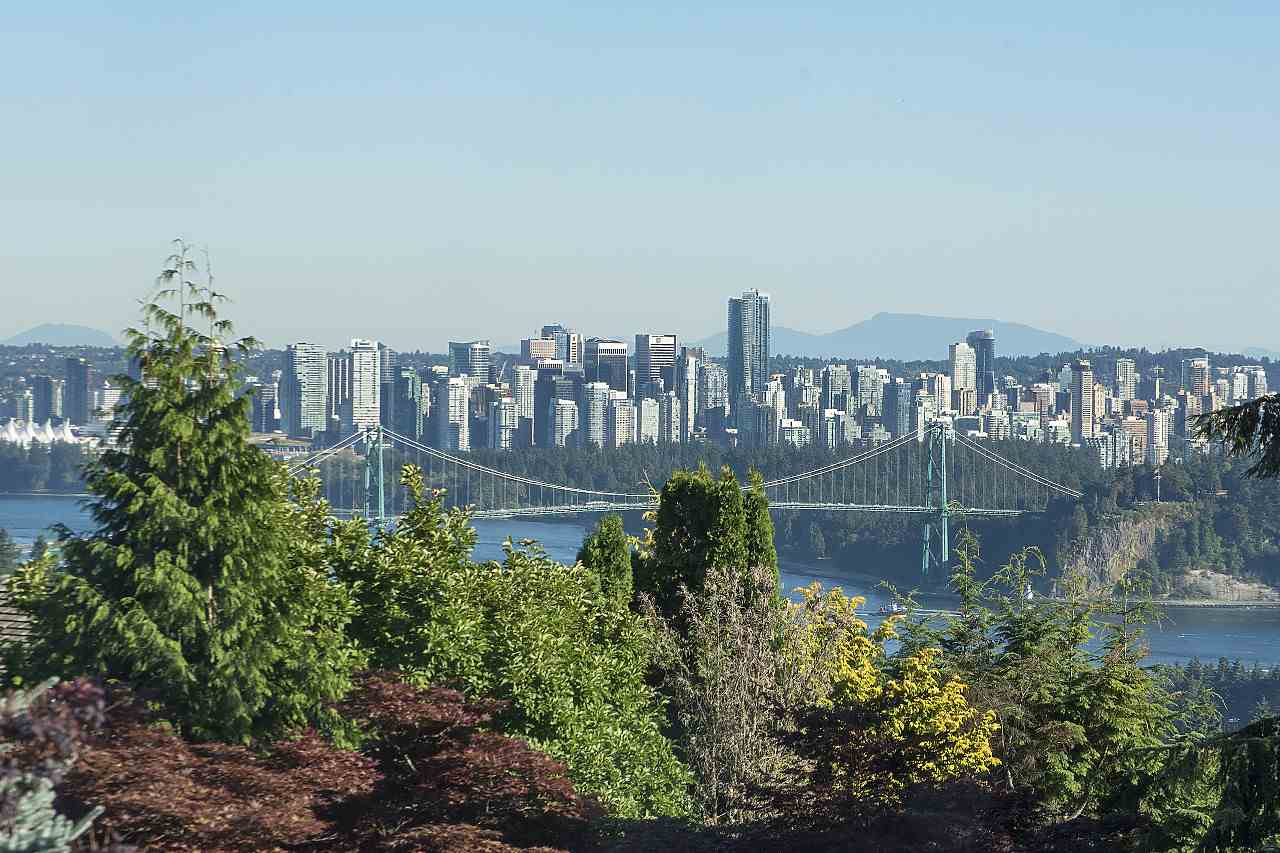 Stunning views spanning from Mt. Baker to UBC! Elegantly renovated with a custom gourmet kitchen, hardwood floors and bathrooms. The floor to ceiling windows bring tons of natural light into the open-concept home with gorgeous views of Mt. Baker, DT Vancouver, Lions Gate Bride, and UBC. Complete with 4 bedrooms, or potential to build a new home in a great location close to the best schools and amenities!
