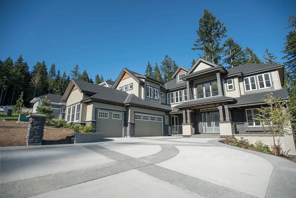 You are invited to take in the stateliness of 26 Heritage Peak Road. This incomparable home is 1 of only 26 perched a top Port Moody's sought after Heritage Woods neighborhood on an ESTATE SIZED greenbelt lot. Sweeping DRAMATIC VIEWS...oh the views from both the front and back will delight your eyes in wonder. A grand open main floor awaits the many gatherings you will host here. Morningstar Home's well thought out almost 6,000 sqft design provides you with 4beds/baths up, 2 kitchens on the main floor as well as 2 offices, one of which has its own entrance from outside. This home should be applauded for both interior and exterior distinction, truly a masterpiece. Brand new never lived in and no GST, super RARE opportunity!