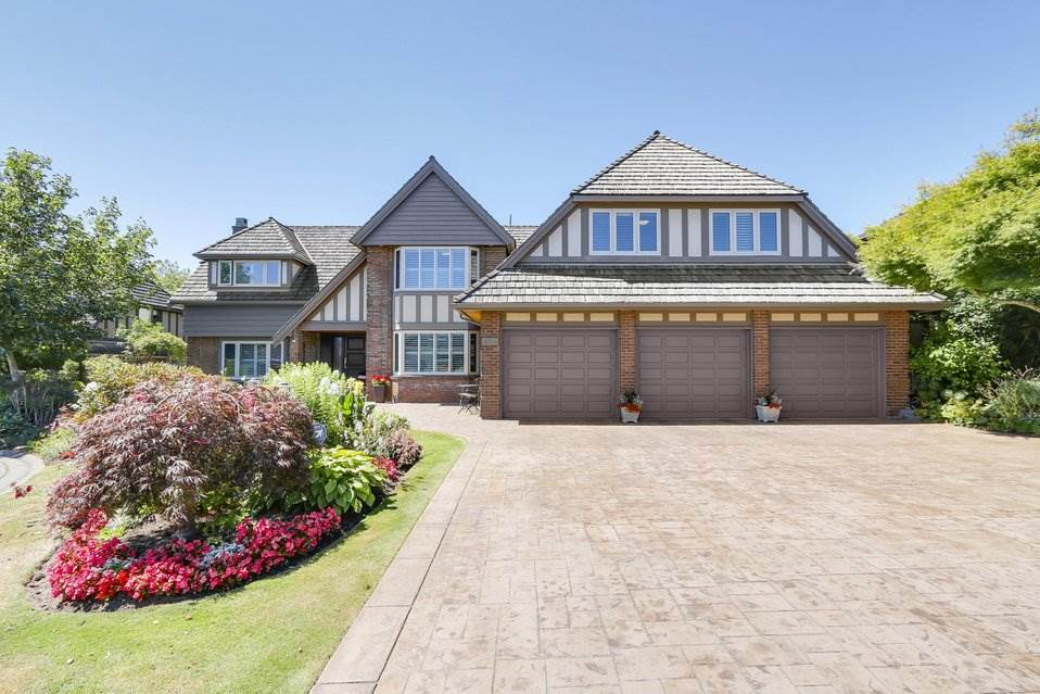 """SHAUGHNESSY"" IN FOREST BY THE BAY! Absolutely beautifully updated 4,435 sq. ft. impressive Tudor style home on a park-like 7,707 sq. ft. lot (108 ft. frontage). This luxury home features 4 bdrms, 2 dens (1 could be a bdrm), massive games room, over-sized master bedroom with fireplace & beautiful 5 piece ensuite. Gourmet kitchen with top appliances, family room off the kitchen, numerous built-in cabinets, California shutters, mud room and 3-car garage. New hot-water radiant heat. Exclusive location with other quality homes. The home was built by Sepp Hauser, a high quality European builder. Within walking distance to schools, recreation, transportation, restaurants, shopping, Beach Grove Grove Golf Course and Centennial Beach! A DREAM HOME WAITING FOR YOU!"