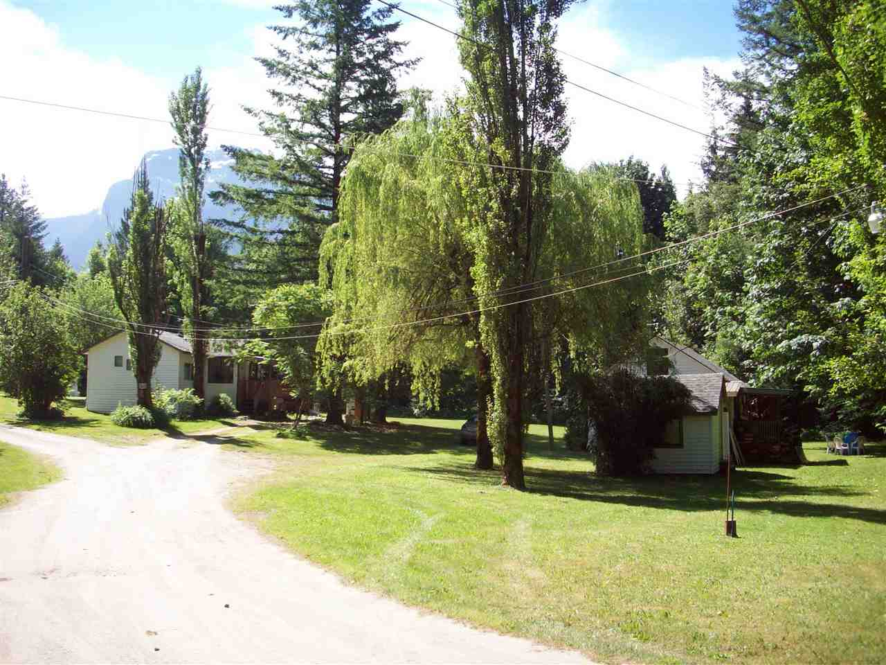 Good value here. Your own little private valley. Unique property 8.5 acres with no neighbours. Just before the Lake Of The Woods and only 5 mins to Hope town center. Very private area with large fir and maple trees and large lawn area. Park like setting. Has 6 rental homes on property, 1 - 3 bedroolm, 2 - 2bdrm, and 3- 1 bdrm, with 3 out buildings and 32 x 30 2 bay shop. All units are rented, never any vacancies. Gross monthly income $4,400.