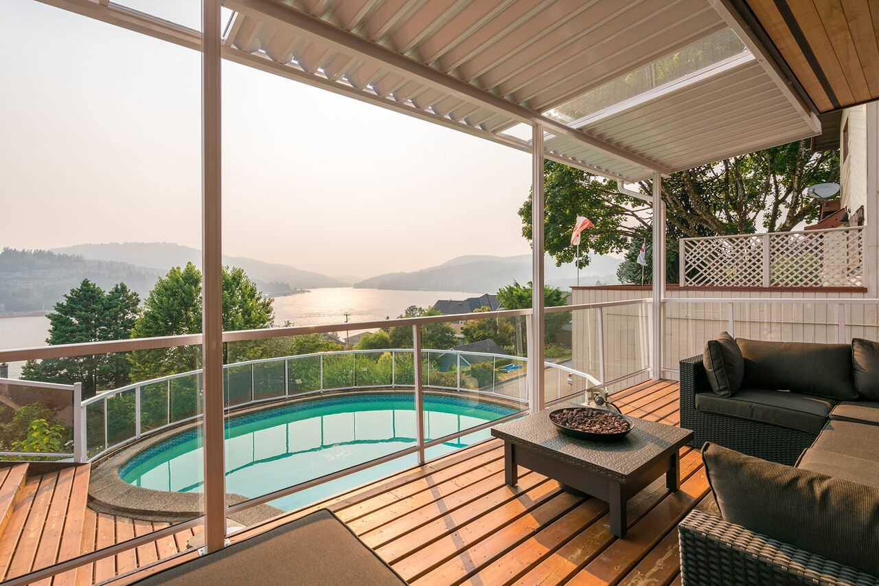 Awe inspiring ocean views from this rebuilt home on what many say is the very best  family oriented & quiet cul-de-sac street in Port Moody's Pleasantside area. Heavily renovated to the studs in 2016, this Southwest facing 4422 SF house sits on a 6897 SF lot. Three bdrms on the upper level & one bdrm with kitchen on lower level with it's own entrance & lane access. Enjoy a dip in your pool while facing the ocean. Quartz countertops, Miele appliances, Kohler fixtures, 4 inch engineered oak hardwood floors, central vac, hardy board & cedar exterior. Pretty Views of Mt. Seymour from Axford Bay. Walk your kids down the street to Pleasantside Elementary. Greenbelt & extensive hiking trails directly behind the North side of the street as well! Minutes to all that Port Moody offers. A must see!