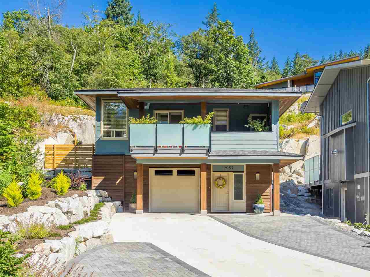 Brand new home found at the end of a cul-de-sac, adjacent to green space in the exclusive neighbourhood of Crumpit Woods. Large 11,126 sq ft lot w/ incredible views of The Chief off the front south facing covered deck w/ gas bbq hook-up. Beautiful & private back patio w/ fire pit and cascading waterfall running down a spectacular granite wall. Dble car garage w/ storage & RV parking in driveway. Incredible value in this home w/ rental revenue from modern, legal studio suite w/ own laundry, loft and outdoor space; 2 sets of appliances incl Fisher & Paykel s/s in main kitchen, 2 walk-in closets, 3 bdrms incl. 2 ensuites. Efficiency & comfort is key w/ on demand h/w system, n/g f/p, HRV & extra insulation for sound reduction. Call to view!