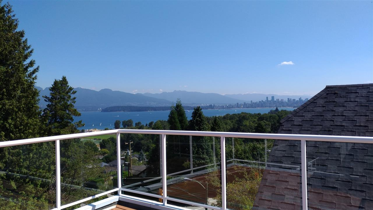 View!View!View! Gorgeous Super North Shore & Downtown view.  Quality home with 3 bedrooms + den, super family room upstairs with view, 2 decks with a fantastic fireworks view. Great landscaping. 2 car garage + 1 carport. Radiant heat all 3 floors, plus lots more. All measurements approximate buyer to verify if important.