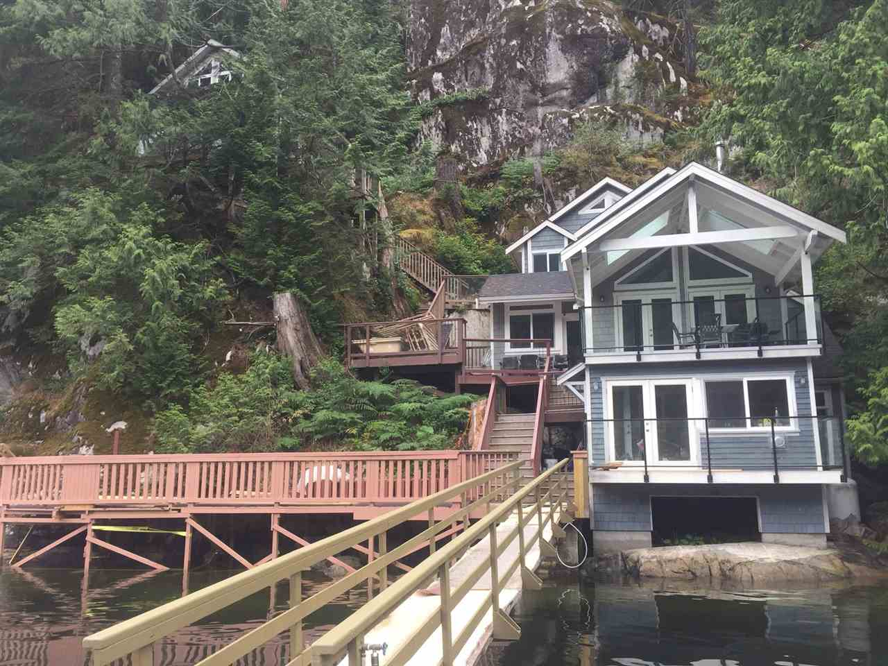Marvelous serene waterfront home is truly an amazing get-away w/breathtaking views of Indian Arm, yet its just 25 min to the city! Picture yourself swimming in the ocean, reading in the sun, fishing off the dock or hosting a BBQ on large deck overlooking your 107 ft of waterfront shore! This property includes a beautifully finished, air conditioned, 3 bed, 2.5 bath & den home w/vaulted ceiling & spacious rooms PLUS a detached guest house just waiting for your creative imagination to finish inside! Direct access from your private boat dock! This lovely home has been completely rebuilt from foundation up, with permits, a home for all seasons! Value is unbelievable at this price! A MUST SEE! Pls make appt. Access by boat only.