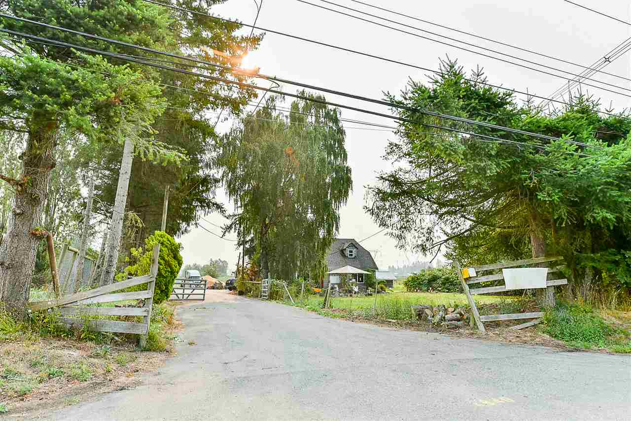 9.9 Acres of rectangular property with approx 8 acres of Blueberry. 60' x 40' barn with high ceilings, plus lean-to's 60'x24' & 45'x16' and 30'x30' shop. Another Storage building. 3 bedroom 1 bath old house. lots of paved parking. Build your dream house with hobby farm. Please call to book showings