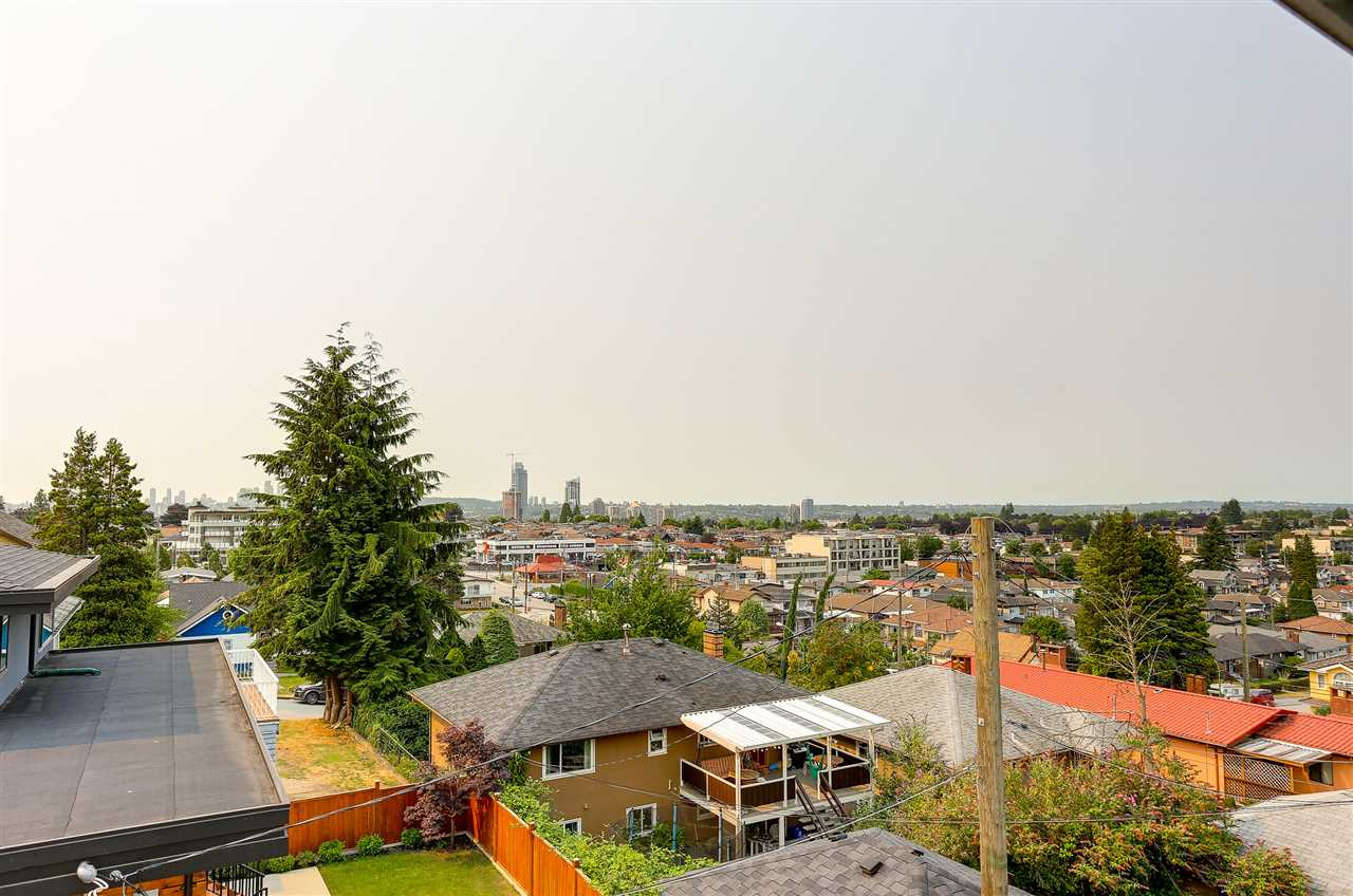 Beautiful & Sunny custom-built 5-bdrm+den executive corner house on a quiet street w/ panoramic City & Mountain Views in prestigious Capital Hill area in North Burnaby. This over 3200 sf. 3-level home features vaulted foyer, bay windows in living room, spiral staircase, fenced home w/front garden & backyard, over extended sundecks, view balconies, spacious bedrooms, wine room & legal in-law suite. Interiors were contemporarily renovated in 2006 with new H/W flooring, new appliances, new paints, new blinds, new decks etc. This sought after location is close to transit, Conferation Park, Public Library, Eileen Daily Community Center, Burnaby Central Railway, trail. Great schools:Conferation Park Elementary, French Immersion & Alpha Secondary. Assessment @ $1,556,000;Unbeatable price!!