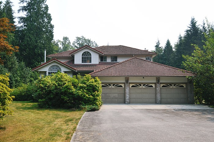 Tranquility Base! 5.2 Acres! Ultra private and Over 290 feet of road frontage, Huge 2 story family home with full basement.  This home is grand and for the entertainer with over sized rooms and a open floor plan.  Featuring 4 huge bedrooms on the upper floor which 2 of them have full en suites! Sunken Family room off the kitchen, formal living and dining rooms, Vault Ceiling, exceptional construction throughout, in floor h/w heat.  Fully finished down with an easy in-law conversion if you wish. Many finishing options down stairs featuring a summer kitchen, full bath, sauna room all ready to finish off. Mint yard and very private, backing on to Kanaka Creek Park! This is a hard to find Executive Home and Large acreage package!