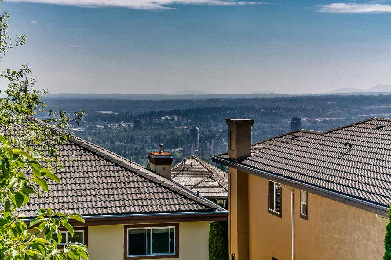 Sophisticated Executive Golf Course living! A Westwood Plateau Gem! Classic golf course living is reflected in this outstanding, fabulous, 5715 sqft plus home with stunning Mount Baker& city views. Exceptional details throughout from the grand foyer with spectacular crystal chandelier, spacious living/dining room, grand family space with custom gourmet kitchen. Century custom cabinetry, top quality granite counter tops and stainless appliances. 7 bedrooms with great 5 bathrooms in three fully finished levels. Spacious lower floor/ with high ceiling and generous use of windows to bring as much natural light in as possible, walk out basement with separate entrance, full bath and sound proof room. Truly one of the most beautiful homes! Open House Sat. & Sun. 2-4pm.