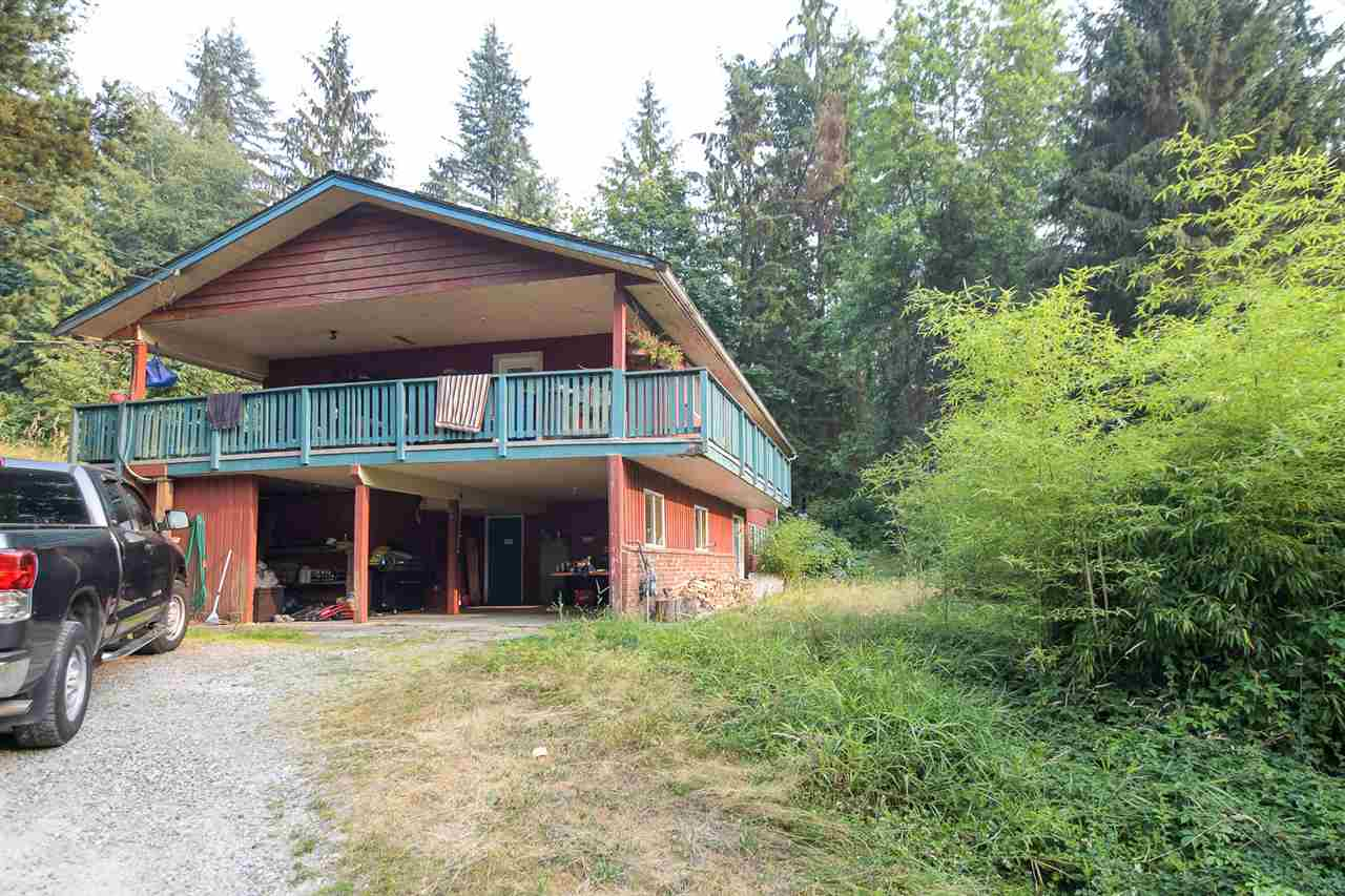 """This Silverdale acreage has 2 homes on it and outbuildings with spectacular views of the Fraser Valley. It can be subdivided into a minimum of 4 acre parcels. If an additional acre is acquired from a neighbor, it could be 3 lots.  A very smart investment with additional income potential. The larger home also has a huge barn that can used as a workshop, for animals, art studio or for anything your heart desires! The large home is rented for $1800 a month and the smaller home which includes many outbuildings, rents for $1100. Future OCP calls for urban lots.  2 wells on the property. Dimension for """"Below"""" are for second house."""