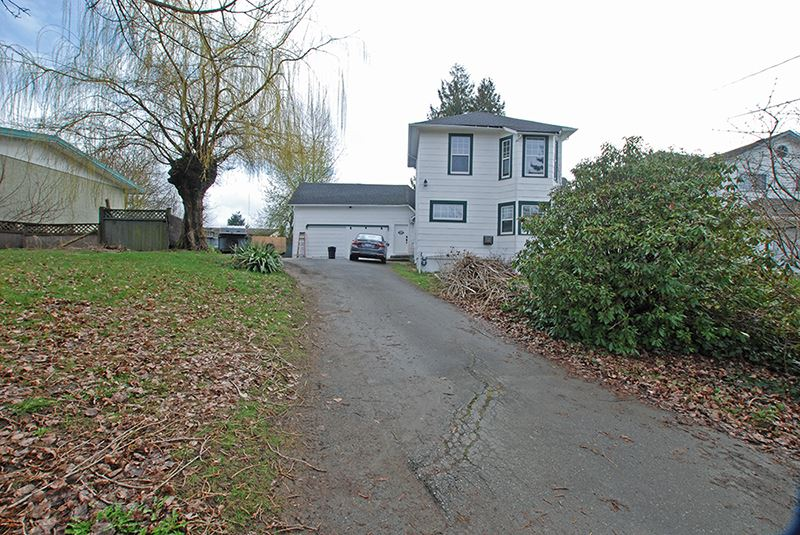 ATTENTION INVESTORS 11,736 sq ft lot, has subdividable potential or a great holding property. Character home lovers this 3 bedroom home is the original farm house, has been expanded with some updates. There is a bonus room in the basement and a loft space above the garage. You will enjoy the large private yard plus lots of parking for all your vehicles/toys. All this in the heart of Sardis, located within walking distance to all amenities and to all levels of schools plus right across the street from Garrison Crossing. As they say Location,Location,Location. $7,000.00 cash back to Buyers upon completion  for flooring or WHY (what have you).