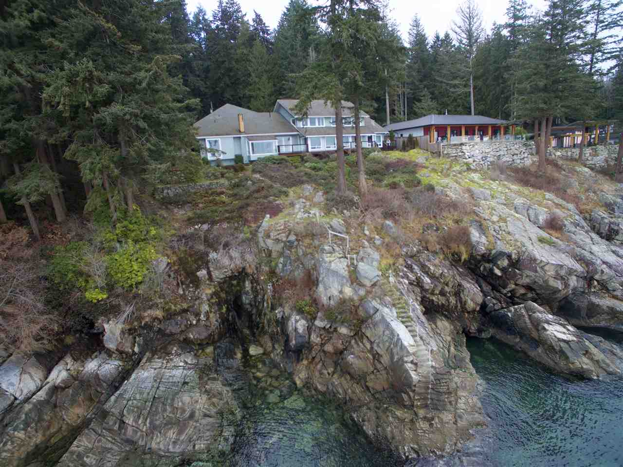 Beautiful, relaxing oceanfront Roberts Creek property. This 4.1 acre gated waterfront property offers privacy with over 200 feet of waterfront & spectacular panoramic views. The 5 bedroom custom home is designed for entertaining & features many upgrade finishing details. With a possibility of a four lot subdivision under the current zoning this offers incredible value for your money!  Call us today for all the details!