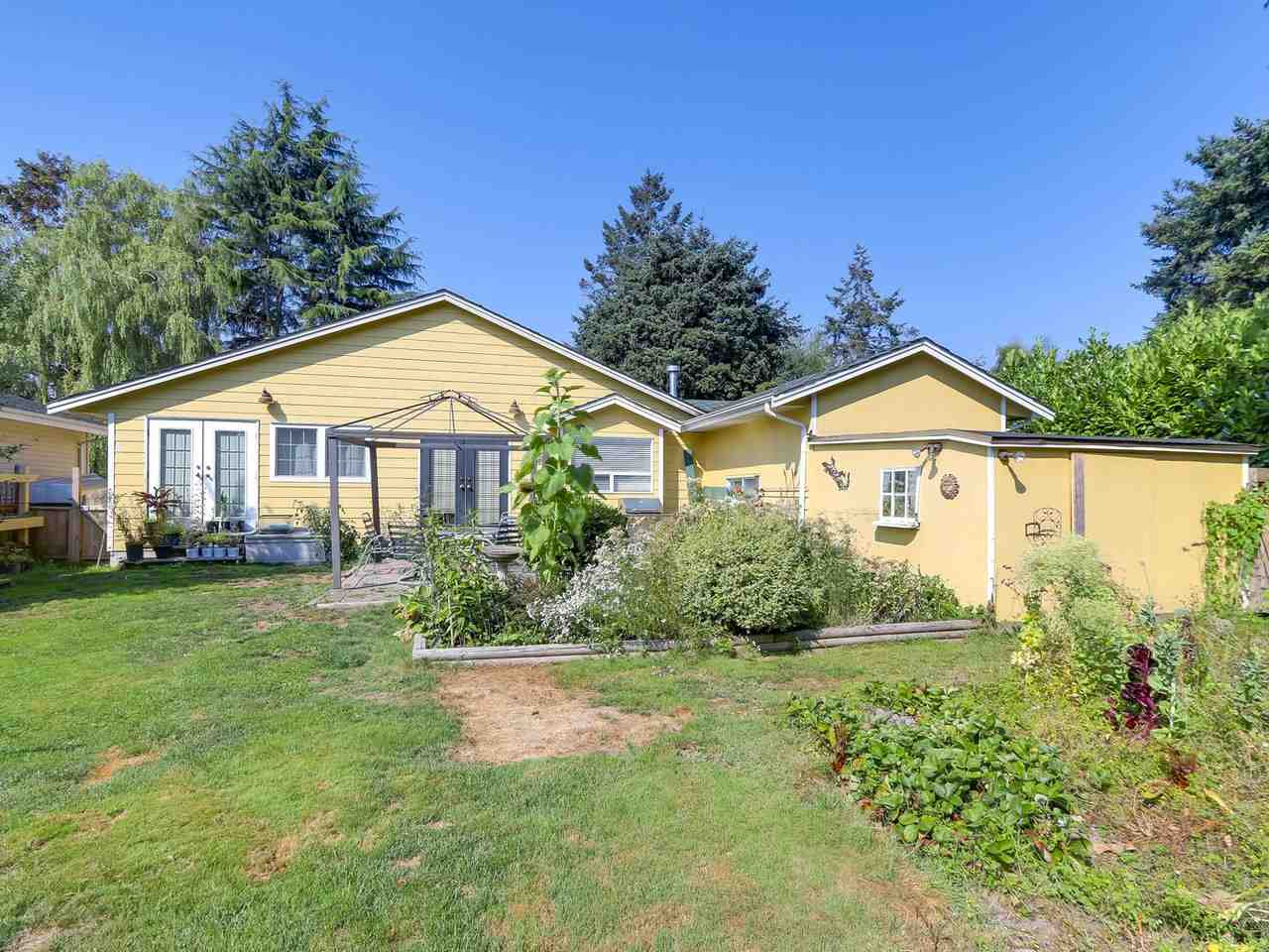 Well kept 3 bedroom 2 bathroom home with a open kitchen, separate dining room and bright family room. Master bedroom features lovely french doors to the back yard and an ensuite. This home is on a beautiful 10,680 sq.ft. lot (60 x 178 feet). Build a new home - up to 4,280 sq.ft. with a 452 sq.ft. garage OR a 3,400 sq.ft. home with a 880 sq.ft. workshop. Close to schools, parks, Ladner Village shopping and restaurants. Potential to subdivide, hold as an investment OR move in and enjoy!
