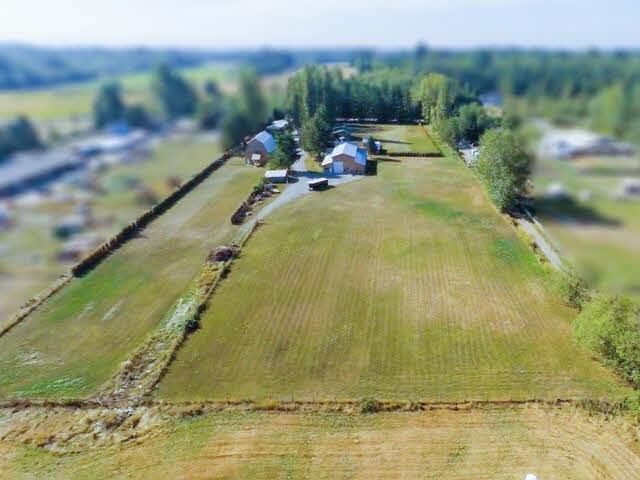 Rare find 28.56 acres w/ beautiful view of Mount Baker. Mostly cleared land ready for farming and building your dream home. Updated 7 bdrm/7 bath 3,950 sq. ft. rancher. 60x60 new construction barn with entertaining space/cowboy lounge and heated dance hall upstairs. 30x50 open timber frame carport. 30x36 shop/garage w/ hoist and 220 wiring. Separate gym building. Character guest house w/ loft bdrm. Tasteful western theme to the whole property. All buildings located at the front of the property, new well and septic. Great location. Minutes drive to border crossing. Endless possibilities for this property!