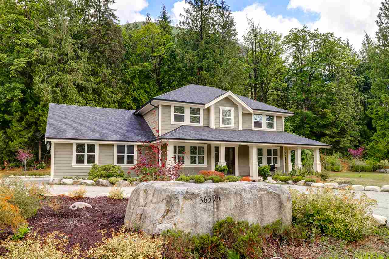 """This farmhouse style home sits on 2.69 acres in an exclusive sbdvision of acreages. 15 min to West Coast express and dwntwn Mission.Bus stops on St. for Hatzic Elementary & High Schools.Cascade Falls 6kms away, not to mention an abundance of creeks, lakes, & dirt biking trails in your backyard!No details spared in this 3 bedroom home, extensive high end finishes, top line appliances, including a full fridge/full freezer combo and double wall ovens.The master suite features his and hers walk in closets and a huge walk in tiled shower.Enjoy exquisite coffered ceiling feature in the foyer.This house was built with attention to detail, including endless storage.Beautiful wrap around porch with handcrafted pillars, wood soffits, cedar flooring and arched openings complete the farmhouse feel.Just bring the dinner bell and  make it your own!"""""""