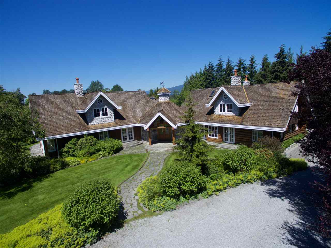 A unique 9.79 acre estate/agri-business property comprising a total of five buildings; main house (+/-4,655 sq ft), event hall (2,325 sq ft), coach house with guest suite (1,490 sq ft), barn with licensed caretaker's quarters (2,100 sq ft) & a stable (1,019 sq ft). The buildings are situated on a meticulous landscaped garden which features a large pond with an island & two bridges. Many other features include 7 acres planted certified organic blueberry field, irrigation/sprinklers & extensive gravel base driveways. This must be seen to be appreciated!