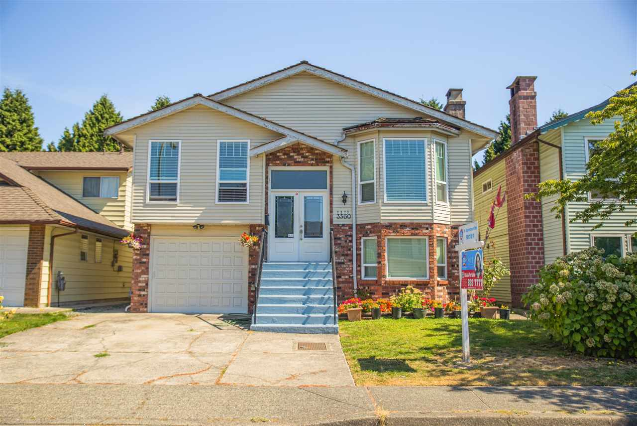 Spacious 5 bdrm home in the popular #5/Cambie subdivision. This 2,600 sq ft home features granite counters, granite flooring, double glazed windows & shake roof, tiles, fridge and stove. 3 bdrms (large deck off the master bdrm) up & rec room w/fireplace, 2 bdrm bsmt suite down. Easy access to Knight/Oak St Bridge. Walking distance to park, community centre, schools, shopping, bus.