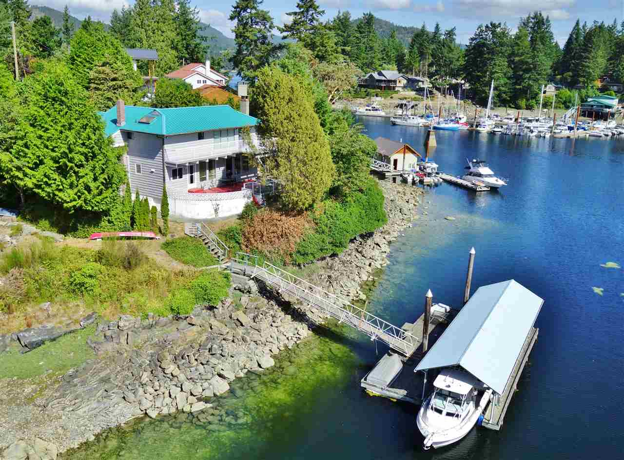 Waterfront investment opportunity!  This 2 level home, nestled on medium-low bank waterfront with a shared dock holds much potential and just  needs some updates and TLC to sparkle!  The home features 3 bedrooms & newer kitchen plus a nice patio to enjoy the ocean view and the lights of the Painted Boat Resort, directly across Canoe Pass and Bargain Narrows.  Spacious yard with both a double and single carport plus space to store the RV or boat.   A few minutes commute to Madeira Park business centre, shopping & health services.  Unlimited recreational opportunities just outside your door.  Please call the listing agent to arrange for a viewing.
