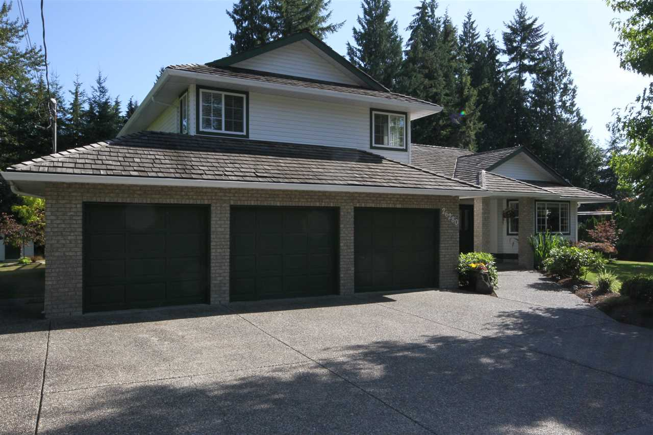 Move To Stanley Park! This gorgeous one acre property shows pride of ownership. From the moment you drive in the driveway you can feel the stress level dropping. Large front foyer overlooks living rm and dining rm with oak engineered floors. Kitchen with new quartz counter tops overlooking eating area, family rm and secluded acreage backyard. Large recreation room for family fun. Upstairs has four spacious bedrooms. Three bedrooms with corner windows and serviced by a four piece bath. Master bedroom will support king size bed and has a 4 pce ensuite. Master bedroom has a new covered deck overlooking peace and tranquility. Side yard will fit a Class A Motor home. This property is only minutes from shopping.