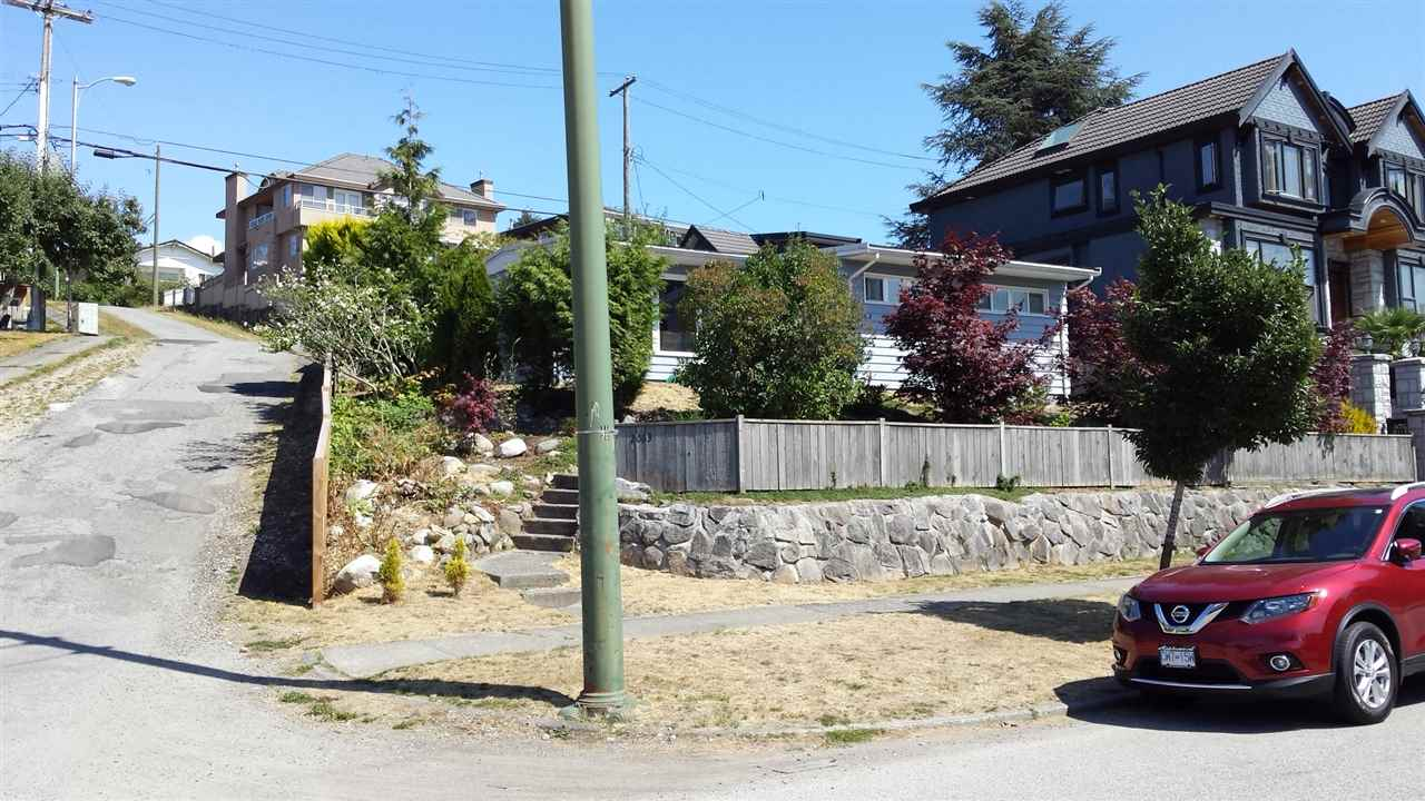 View building lot situated on the high side of a quiet street in desirable Fraserview near transit and schools. This 5,374.57 sq ft lot is a south facing 'corner' lot with side and rear lane access offering the opportunity to build a substantial new home and laneway house which will benefit from south/west views towards Richmond and vancouver  island. One of the last remaining undeveloped lots available. Or live in or rent a very livable easy to maintain 3 bdrm home with basement suite potential. Home has all updated windows and a good worry free roof. A  good investment for the future. Call now for more information.