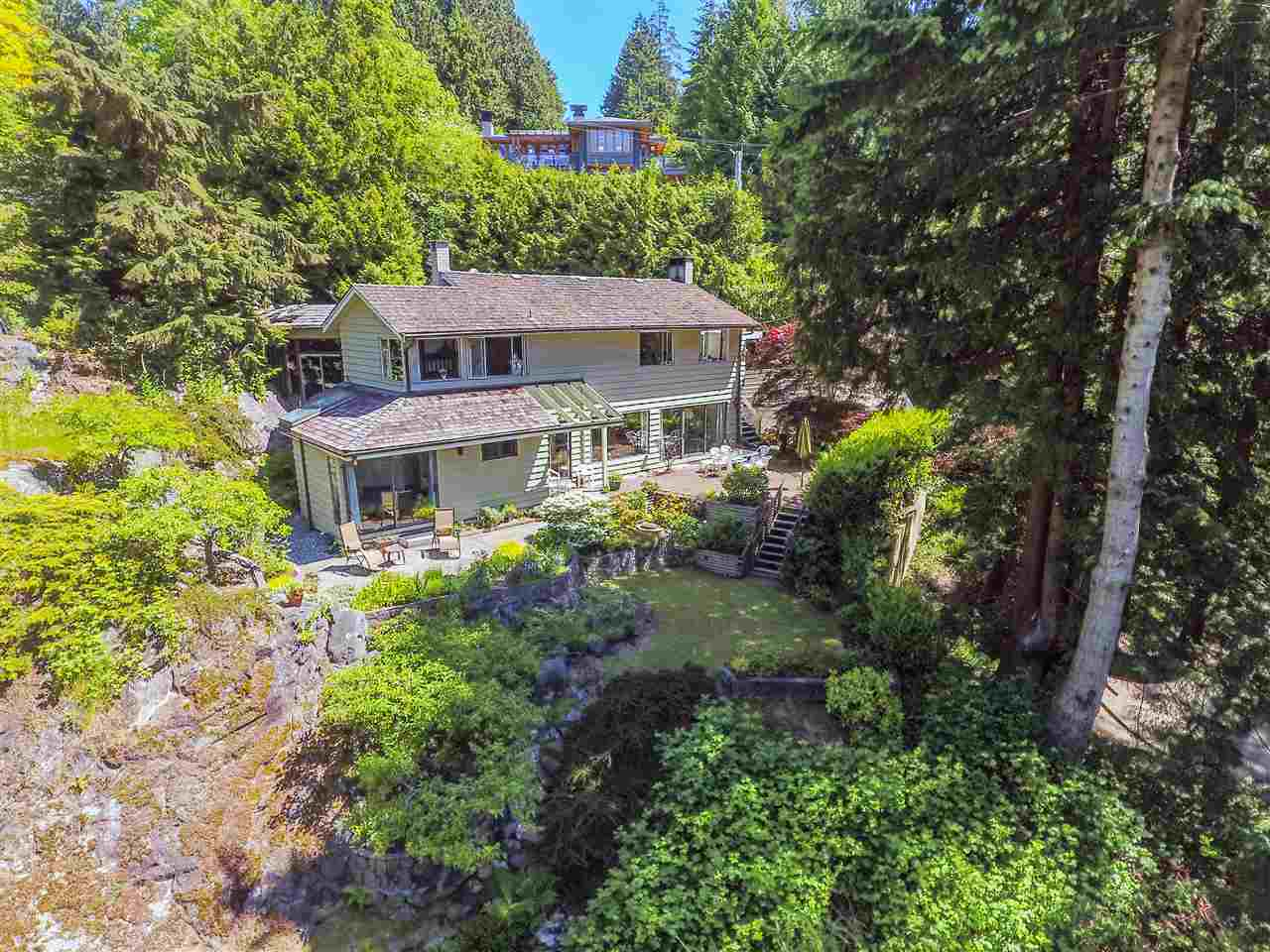 At nature's edge, situated next to Klootchman Marine Park, west of Lighthouse Park, this well cared for home is ripe for renovation or live-in and plan your dream home. Very unique home with an indoor pool, lovely stone terraces, water views and total peace and serenity.