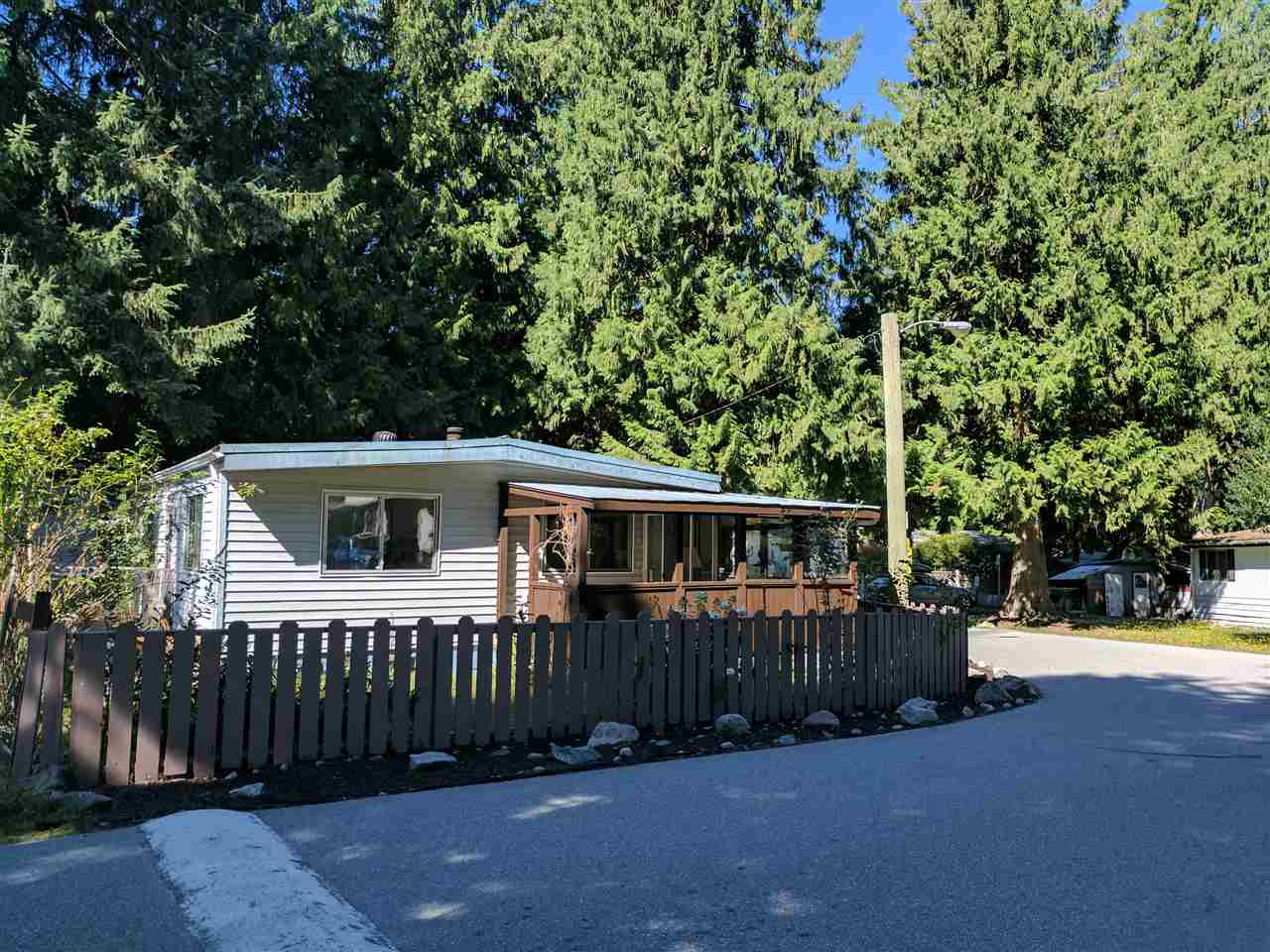 Large fantastic corner lot for this very well priced 3 bdrm home in central Squamish's Timbertown Estates manufactured home park. Surrounded by big beautiful mature trees, this is the best priced real estate opportunity in town. In addition, there is a wired workshop and lots of extra storage. Enjoy the wrap around sun room and deck as well as a large foyer/laundry room. Additional features include newer appliances, spacious bedrooms, parking for up to 5-6 vehicles/RV/boat and lots of windows view the beautiful natural landscape. Please call the listing realtor to set up your viewing appointment. Thank you for your interest.
