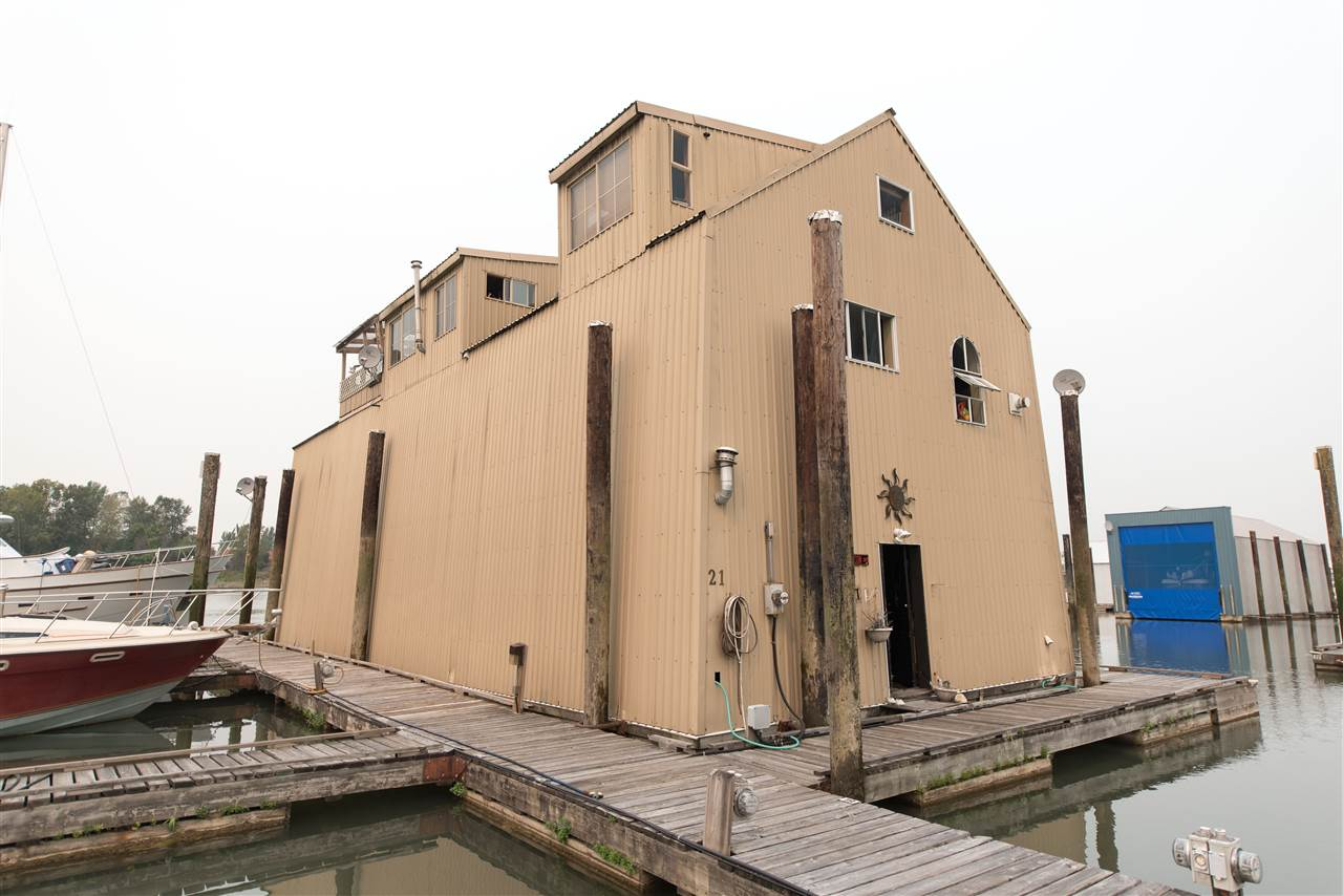 Combine living on the water with covered moorage for your 60' ft boat. 28' x 69' boatshed has 1624 sf furnished apartment with 2 bedrooms and 2 bathrooms plus lots of extra room for storage and workshop. Boat slip currently has a 2003 60' Meridian 580 in it (which is for sale separately) Annual Moorage is approximately $20,000. The marina has locked access to docks. Secure moorage with 2 parking. All measurements are approximate. Mortgages not available for this type of property. Viewings through Realtor only. Do not disturb marina staff. A Boating Bachelor's paradise!