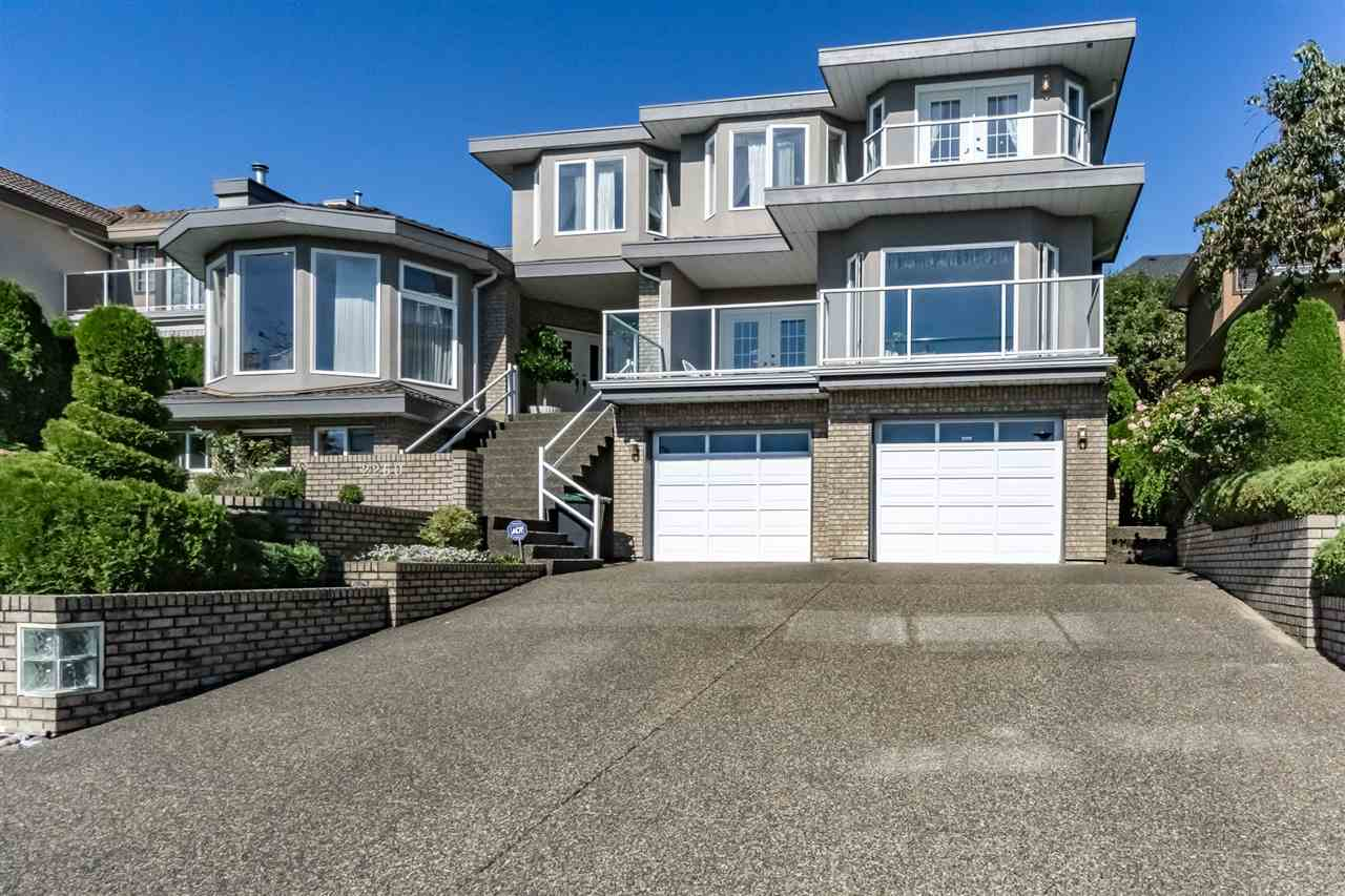 """A REAL HIDDEN GEM!! Architecturally designed and built home with stunning view of Mt. Baker and Fraser River located in most desirable and prestigious area in Coquitlam. This 2 storey with fully finished basement home offers greatly well maintained 7 bdrm and 4 bath. The solid raised gourmet kitchen boasts a 48"""" thermidor stove with 9' huge granite island. The elegant dining room seats 16 comfortably. Special features of this home include large ample storage room, laundry chute, games room, crown mouldings, porcelain tiles, downstairs kitchen, 50 yr roof when built, 3 fireplaces, a master bedroom with sitting room and a stunning view of Mt. Baker."""