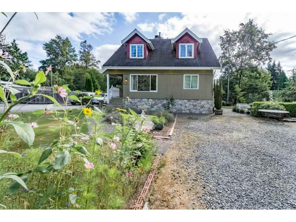 Exquisite country property located just minutes from downtown Langley, Walnut Grove and Hwy 1. This 1.38 acre gem features a beautiful and tastefully updated 3220 sqft home featuring ORIGINAL edge grain fir floors, granite counter top kitchen with beautiful cherry cabinets a high end Bertazzoni gas range and stainless appliance package. This stunning  5 bedroom home is set in a park like setting among extensive gardens, mature trees and a large gazebo overlooking the waterfalls and fish ponds. A truly rare find that includes a large heated shop measuring approx 30x50' and has a large mezzanine and separate 200 amp service. Don't let this property slip away. Call today for your private tour.