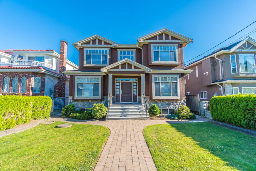 Custom built 3-storey home!! Prestigious home located on a huge lot 47 x 205 sf, a prime property in South Vancouver. 5337 sf house in 3 stories, 3 bdrms (4 master bdrms plus den on above, 1 bdrm on main and potentially two 2 bdrm suites in bsmt) 9 bathrms (7 full bathrms, and 2 powder room), 2 steam room, jacuzzi, big balconies in 2 master bdrms, bar, spacious living rm, family rm, sizable kitchen plus spice kitchen; high end appliances. High ceiling, granite foyer, many granite features in the whole house and HRV, A/C, surround sound system and security sys. House offer exquisite privacy backyard with fantastic gardening view and landscaping, triple garage.open house: Sept 2nd and Sept 3rd, 2-4 pm